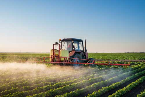Tractor Spraying Crops